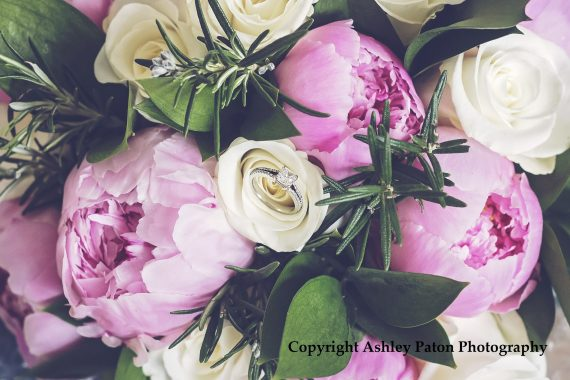 Close up of white rose and pink peony bouquet